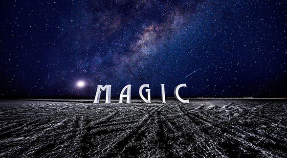 The Word Magic on desert landscape at night with stars