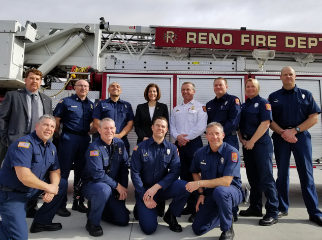 Senator Catherine Cortez Masto with Reno Firefighters in front of firetruck