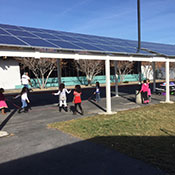 Solar panels on patio structure at a school