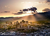 Overview of Reno with sun shining down through clouds