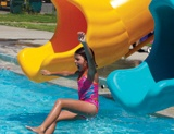 Girl Falling into Pool on Waterslide