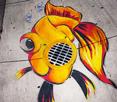 Goldfish painted over sewer drain