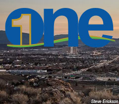 One website logo with overview of City of Reno behind it