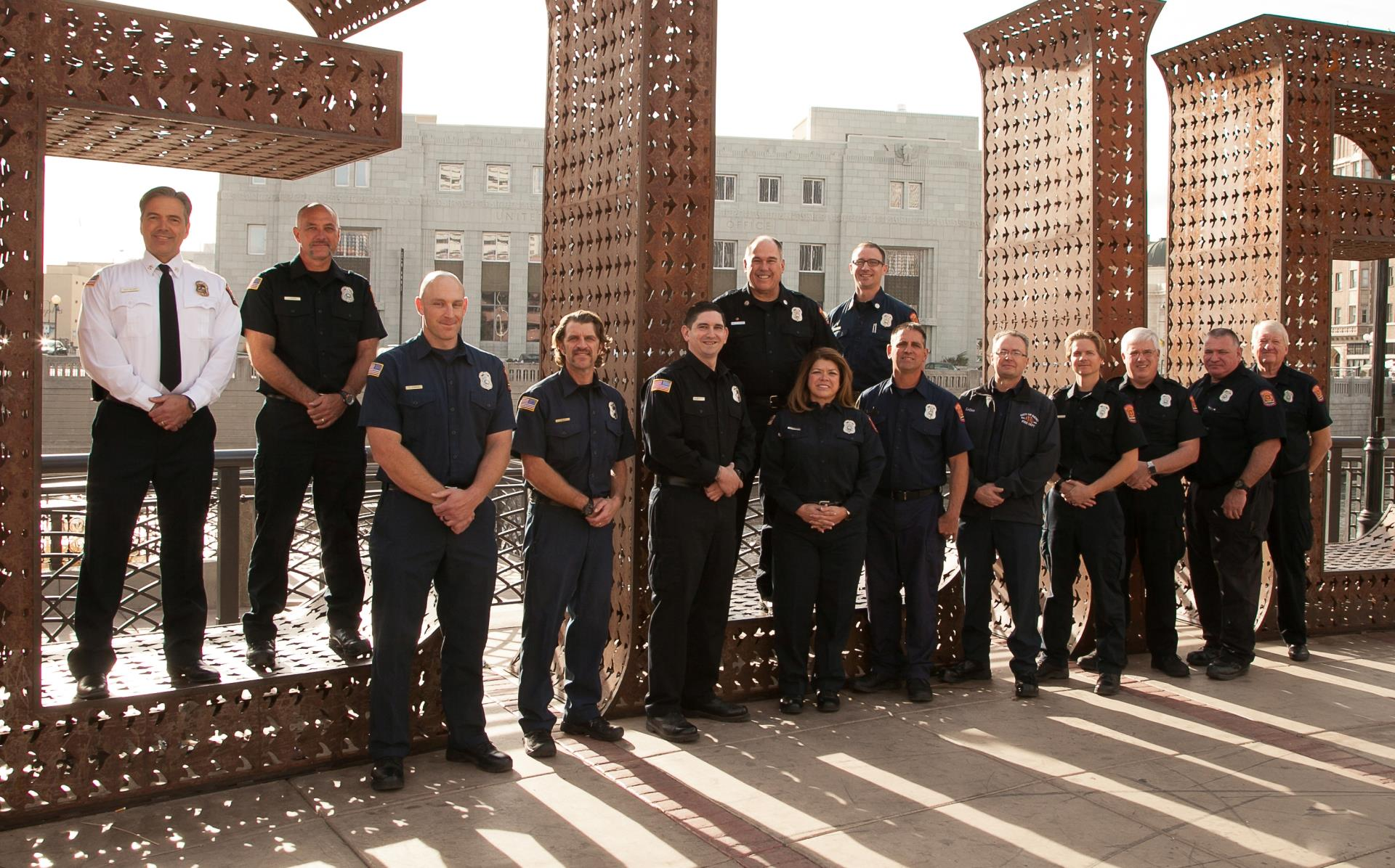 Reno Fire Prevention Bureau staff in front of Believe art sculpture on City Plaza