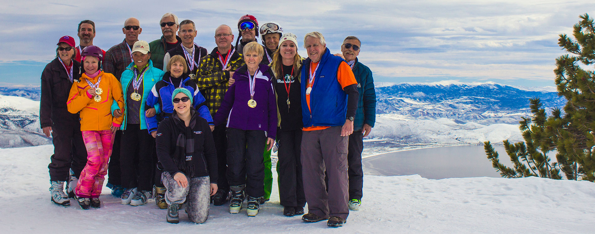 Group of seniors on ski mountain with Lake Tahoe in background