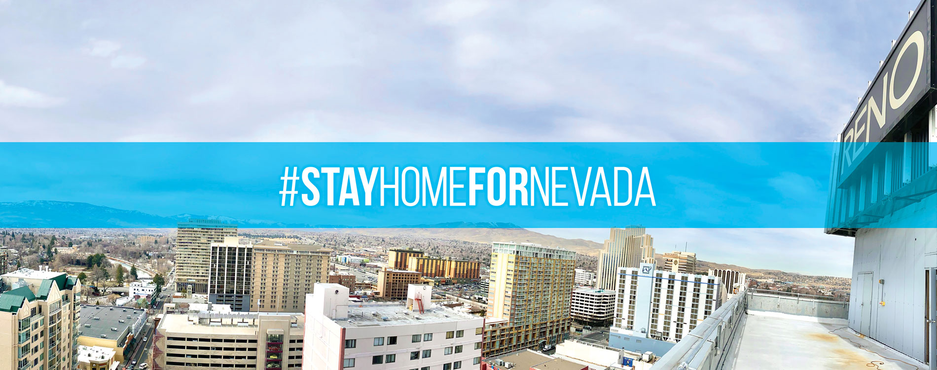 Skyline of Reno with #StayHomeForNevada