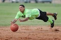 Man Diving For a Kickball