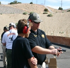Citizens Police Academy attendee learns about gun safety.