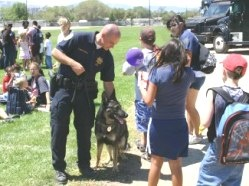 Kids visit with K-9 and handler at Cops and Kids Picnic